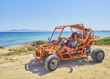 A Happy Girl Driving A Buggy O...