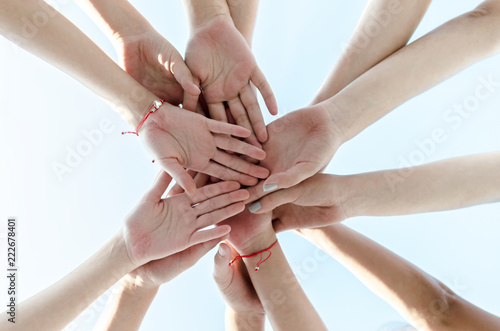 Crossed hands of female team