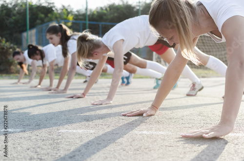 Female handball players doing push-ups