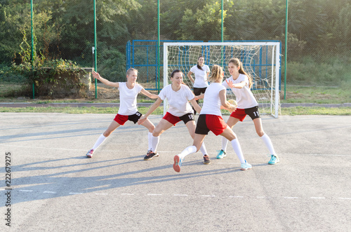 Obraz na plátne Female handball team playing a match