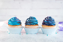Three Cupcakes With Galaxy Whi...