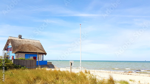 Photo Stands Roe House with Roof ree or thatch on the beach