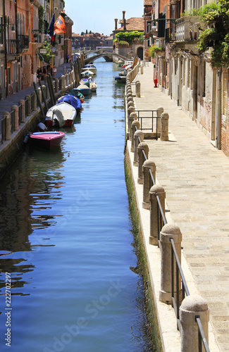 Fotografie, Obraz  Venice - narrow canal - famous place, Veneto, Italy;  attraction, sightseeing, vacations, travel, tourism