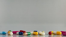 Different Medicine Capsules An...
