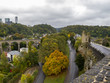 View to the Hollow Tooth - the ruins of a tower of one of the fortress gates in Luxembourg City, Grand Duchy of Luxembourg and the Passerelle on a rainy October day