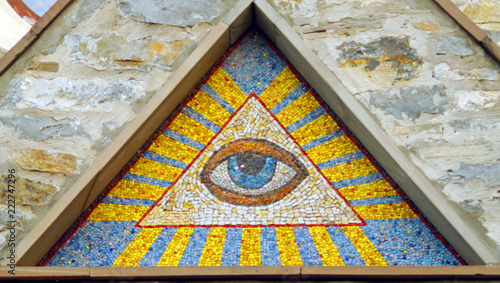 Fényképezés  All-seeing eye of God - a mosaic of wall background medieval church