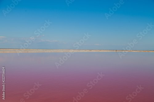 Staande foto Crimson Pink Lake with blue sky landscape background