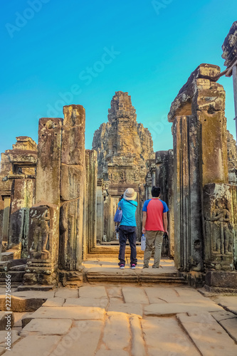 Fotografie, Obraz  Couple stand infront of bayon temple siem reap cambodia,wonder of the world,travel concept