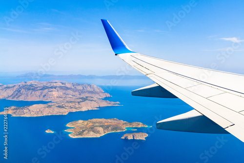 Aerial view of sea and greek islands with airplane wing