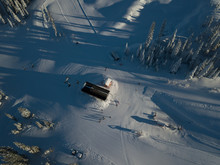 Aerial Photo Of Skiing Trails And Runs Go Through The Beautiful Forest Covered Mountains