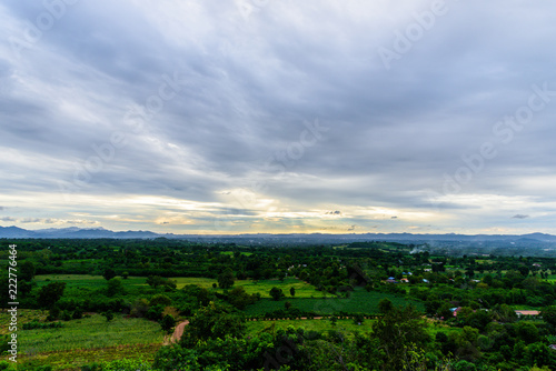 Landscape of cloudy, mountain and forest with sunset in the evening from top view.