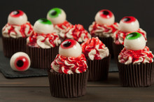 Halloween Cupcakes With Eyeballs. Blood Topping. Home Baked.