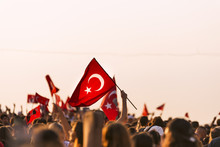 Turkish Flag In Crowded People.