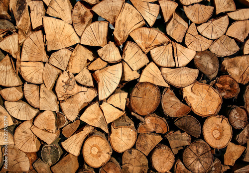 Door stickers Firewood texture A pile of stacked firewood, prepared for heating the house.