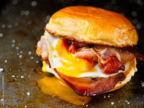 Fényképezés  rustic bacon egg breakfast sandwich bun