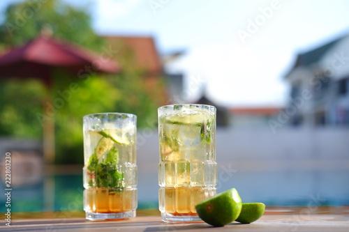 Fotografie, Obraz Mojito cocktail glass on wooden table