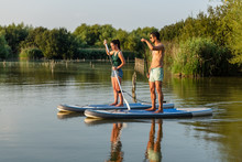 Man And Woman Stand Up Paddleb...