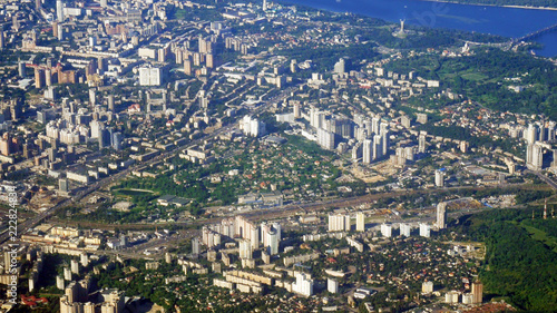 Kiev city from fly aircraft view, little buildings, parks and river