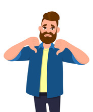 Unhappy Young Man Showing Thumbs Down Sign Gesture. Dislike, Disagree, Disappointment, Disapprove, No Deal Concept.