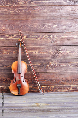 Retro violin on wooden background  Old violin, bow and copy