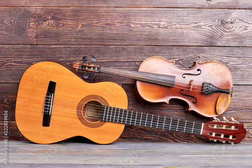 Leinwand Poster Musical instruments on wooden background