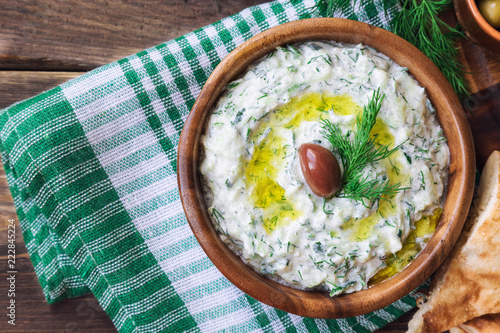 Tzatziki sauce in wooden bowl