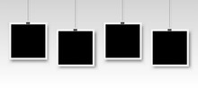 Four Photo Frames Hanging On A...