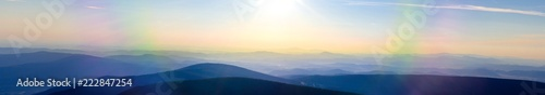 Fototapeta Panoramic morning view from the peak of Snezka, the highest mountain of czech republic in the karkonosze national park, looking to the Svorova Mountain, showing the border between to Poland obraz