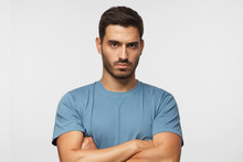 Young Man In Blue T-shirts Tan...
