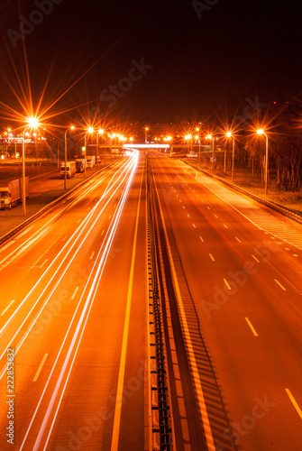 Highway, road at night, light trails on freeway
