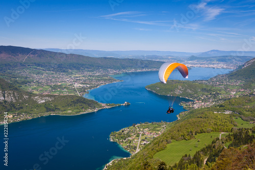 Lake Annecy (Lac Annecy) in French Apls, France. View of the Annecy lake from Col du Forclaz. Paragliders with parapente jumping of Col de Forclaz near Annecy in French Alps, in France.