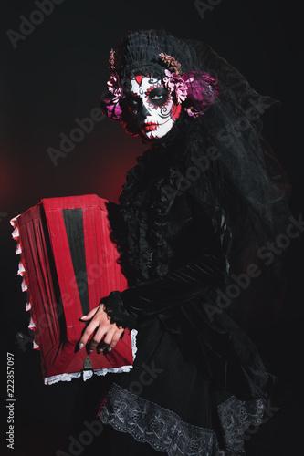 Spoed Fotobehang Halloween a coffin in hands