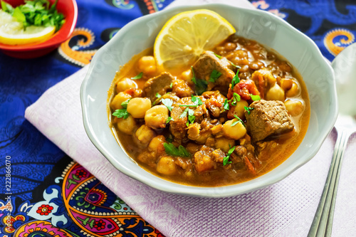 Moroccan lentil soup harira with meat, chickpeas, tomato and spices.