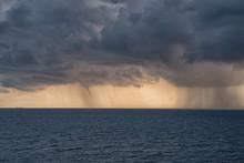 Dense Rain Clouds And A Tornado Over The Sea