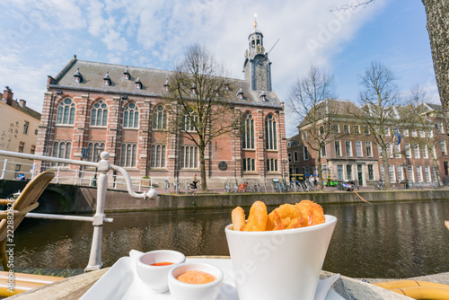 Poster Cracovie Exterior view of the historical Leiden University church with fried seafood