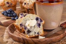 Blueberry Muffin With Butter And Cup Of Coffee