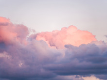 Gorgeous Close Up View Of Fluffy Cumulus Clouds With Pink And Purple Hues Resembling Delicious Mouthwatering Cotton Candy.
