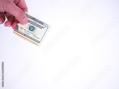 Fotografering  Photograph of a Caucasian male hand holding a folded twenty dollar bill handing it downward isolated on a white background