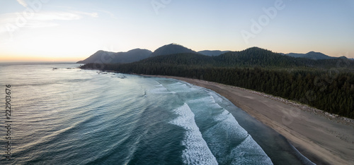 Aerial panoramic view of a beautiful beach on Pacific Ocean Coast druing a vibrant sunny summer sunset. Taken in Raft Cove Provincial Park, Nortern Vancouver Island, BC, Canada.