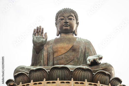 Tuinposter Boeddha Tian Tan Buddha (the Big Buddha) is large bronze statue of a Buddha Amoghasiddhi in Hong Kong.