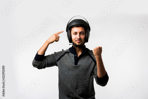 Obraz na plátne Handsome Indian/asian man in helmet over white background with different express