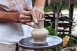 Human hands make a clay jug close-up. Sculptor's workshop. The sculptor makes a jug of clay close-up.