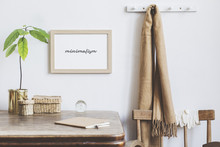 Stylish Interior Design Of Kitchen Space With Small Table With Mock Up Frame, Straw Box, Avocado Plant And Notebook . Minimalistic Interior, White Walls.