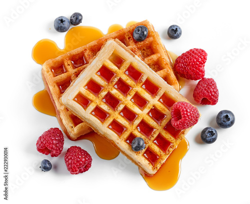 waffles decorated with honey and berries