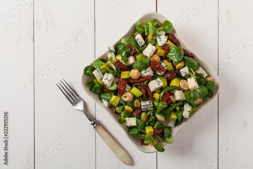 Italian salad with avocado, gorgonzola cheese.
