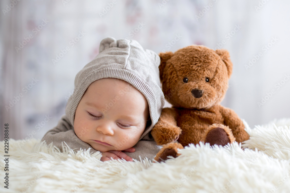 Fototapety, obrazy: Sweet baby boy in bear overall, sleeping in bed with teddy bear