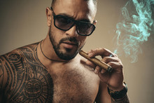 Muscular Athletic Sexy Male With Naked Torso. Brutal Handsome Man With Tattooed Body. Stylish Bearded Man. A Beautiful And Charming Man With Sunglasses. Dark Sunglasses.