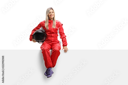 Papiers peints Motorise Female racer in a suit sitting on a panel