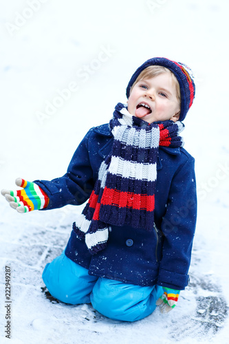 cd8d45ed8 Cute little funny kid boy in colorful winter fashion clothes having ...