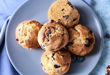 Plate With Tasty Blueberry Muffins On Table